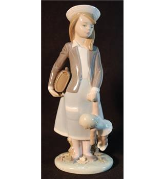 Lladro figurine #5218  Schoolgirl carrying Doll & Bag.