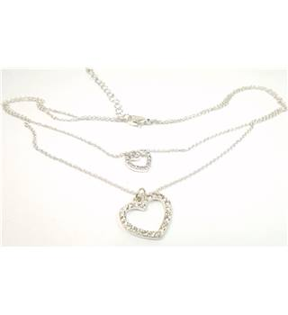 Silver tone 2 strand necklace with clear faceted crystal heart pendants