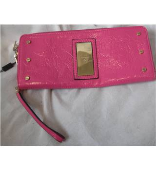 Fiorelli pink wet look zipped clutch bag