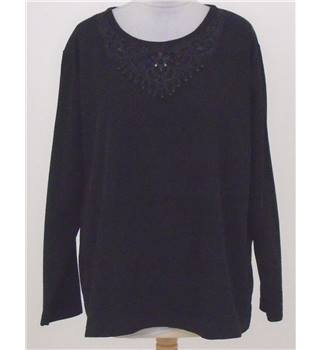 BNWT Isle size: L black sequinned top