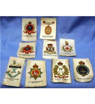 Silks. Regimental Insignia. 9 Silks (1 duplicate)