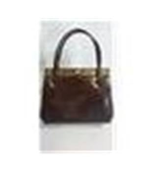 Brown leather lined vintage handbag