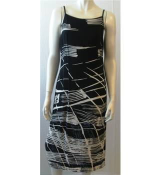 M&S - size: 12, black and cream patterned calf length dress