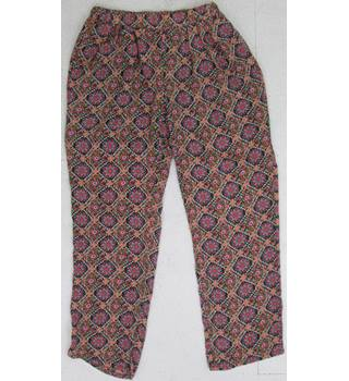 Cutie  Size: 16 red floral patterned  Trousers
