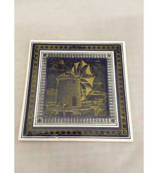 Vintage Titov Veles ceramic tile featuring a windmill.