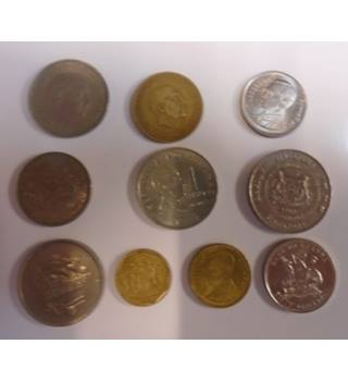 A MIXED LOT OF 10 WORLD COINS
