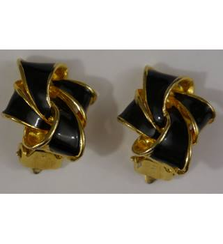 Gold and black ribbon effect clip on earrings