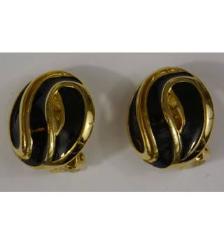 Brand new black and gold clip on earrings