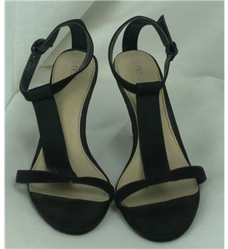 Next, size 6.5 black high heeled sandals