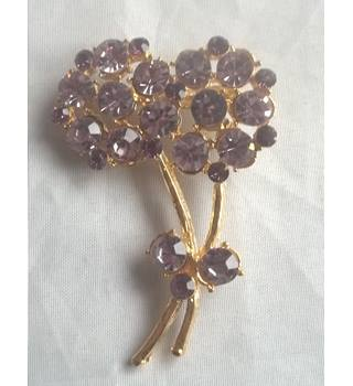 Gold Coloured Flower Brooch With Purple Stones