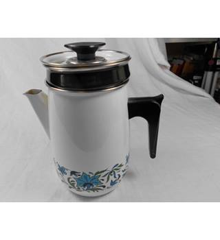 Vintage enamel coffee pot with filter. Not known