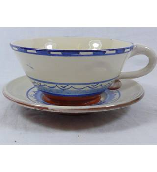 A lovely art pottery cup and saucer