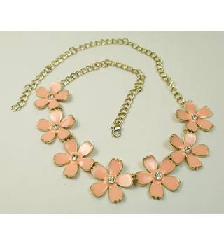 Gold tone curb chain with coral pink & clear facet flowers