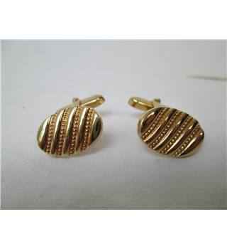 Gold coloured oval cuff-links