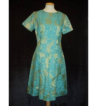 Used: Very good  Lee Holliday Fashions Size 12  Vintage green short sleeved knee length dress with turquoise jacquard roses