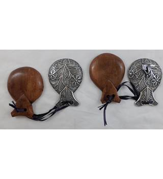A Pair of Decorative Filigree Castanets.