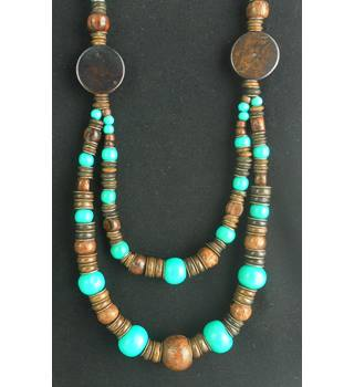 Statement Wood And Brass Necklace With Turquoise Coloured Wooden Beads