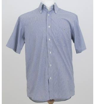 Lacoste  Size: L  White and navy stripes shirt