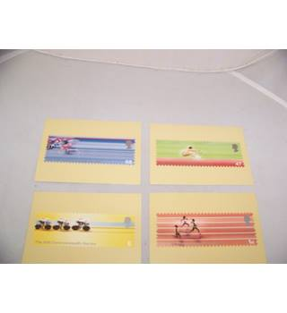 4 royal mail postcards - the friendly games