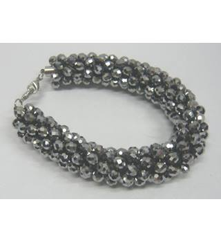 Chunky, sparkling grey, faceted stone clustered curve bracelet Unbranded - Grey