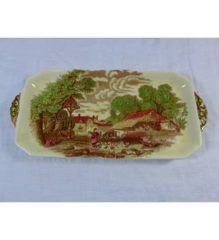 Royal Staffordshire dinnerware by Clarice Cliff. Rural Scenes