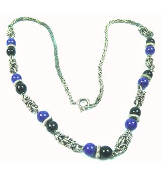 Silver tone twisted chain necklace with lapis lazuli beads
