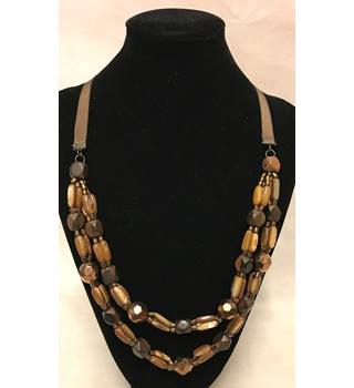Unusual double strand glass, shell, and wooden bead combination necklace.