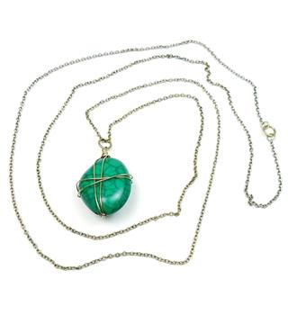 Gold tone cable chain with faux green gemstone pendant - long