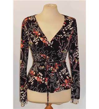 Warehouse size 10 black with white, pink and green floral patterned top