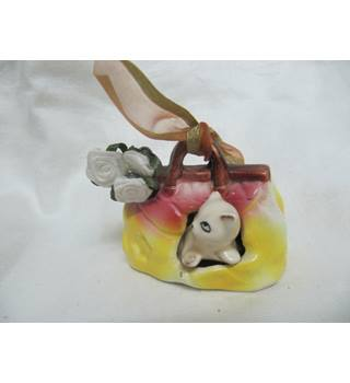 Ceramic Cat inside Ceramic Handbag