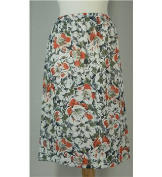Home made size: 14 white with orange and green A-line skirt