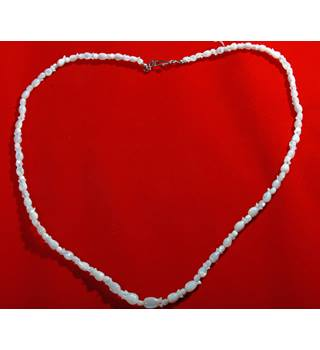 White necklace with glass tulip style beading in pearlescent white. 24 inches long.