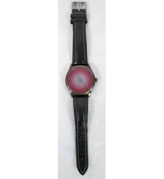 Red Herring large ladies watch with black leather strap.