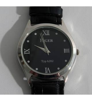 BNWOT Eiger men's wristwatch with black faux leather strap.