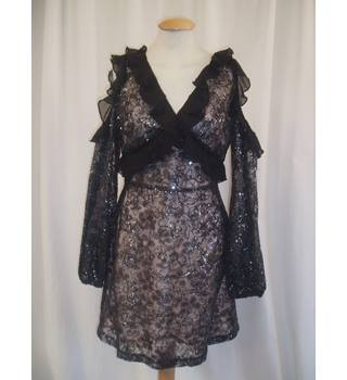 BNWT  Dolly Delicious - ASOS  Size 8 Black cold shoulder ruffle trimmed metallic lace overlay dress with flesh lining.