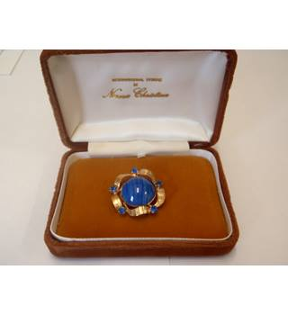 Gold plated brooch with blue stones in Norma Christina box Norma Christina - Size: Medium - Metallics