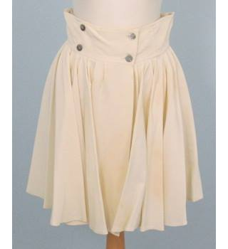 Nicolas Georgiou: Size M:  Ivory front wrap pleated mini skirt