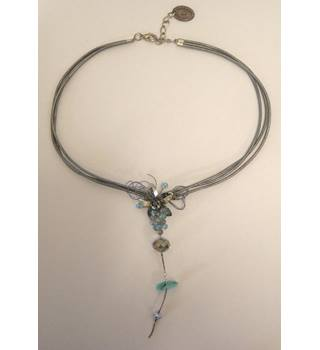 Hand made necklace, silver coloured cord holding silver coloured flower centre piece, Catherine Bijoux