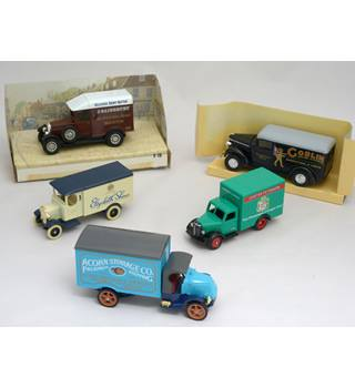 A collection of five diecast delivery vehicles. Matchbox, Lledo and Days Gone