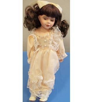 15 inch porcelaine doll in pink