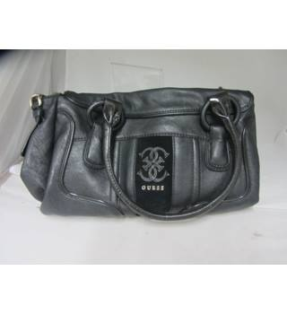 Ladies GUESS bag with cloth bag