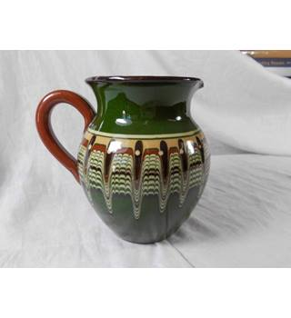 Green , brown slipware jug in style of Bulgarian Troyan Redware, art pottery.