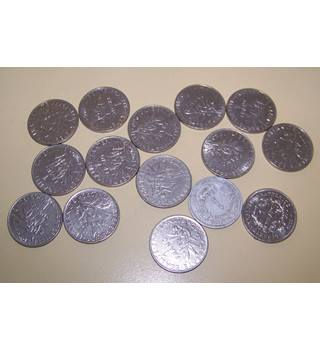 An assortment of French 1 franc coins