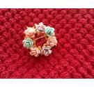 small brooch with coloured flowers