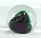 Large Glass paperweight with dark green sparkly cone shaped inner feature.