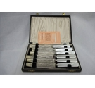 A vintage boxed set of stainless steel pearl handled tea knives