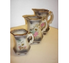 Staffordshire pottery graduated mayfayre jugs