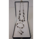 M and S silver metal necklace, bracelet and earrings set
