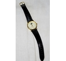 'G' quartz wristwatch in gold-tone with black faux leather strap.