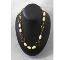 Gold metal rings and cream coloured bead necklace